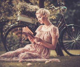 Girl with a bicycle resting in the bosom of nature Stock Photo (3)
