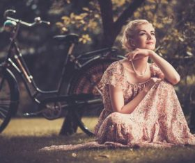 Girl with a bicycle resting in the bosom of nature Stock Photo (5)