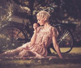 Girl with a bicycle resting in the bosom of nature Stock Photo (6)