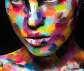 Girl with colored face painted Stock Photo 02