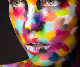Girl with colored face painted Stock Photo 04