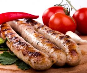 Grilled sausages and tomato peppers Stock Photo