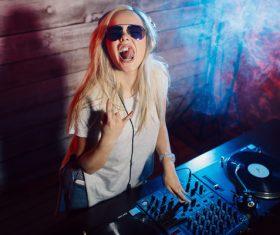 Grimacing DJ girl Stock Photo