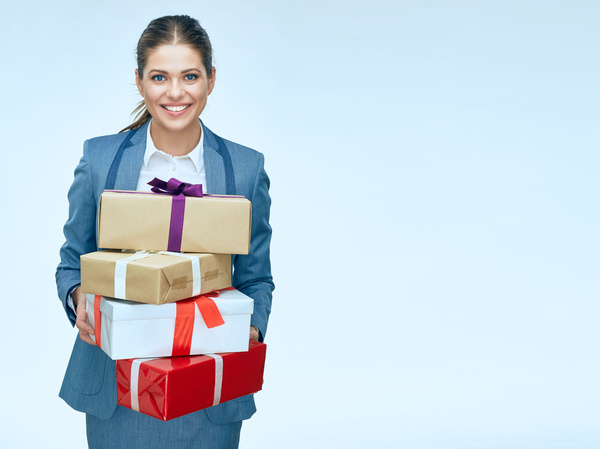 Happy business woman with gift boxes Stock Photo 02
