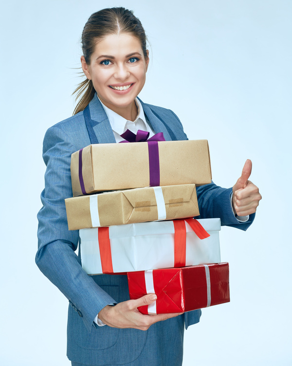 Happy business woman with gift boxes Stock Photo 09