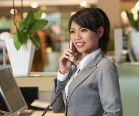 Hotel front desk attendant Stock Photo 01