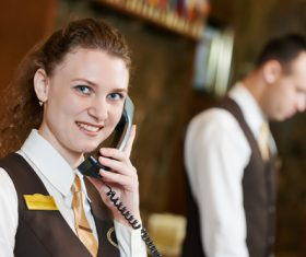 Hotel front desk attendant Stock Photo 04