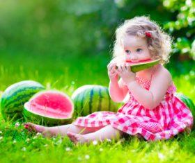 Joyful children are eating a watermelon Stock Photo (1)