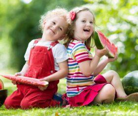 Joyful children are eating a watermelon Stock Photo (3)