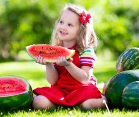 Joyful children are eating a watermelon Stock Photo (4)