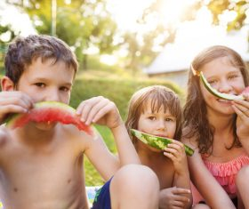 Kids eating watermelon Stock Photo