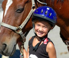 Little girl and horse Stock Photo