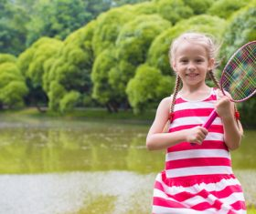 Little girl holds tennis racket Stock Photo