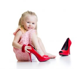 Little girl wearing high heels Stock Photo 01