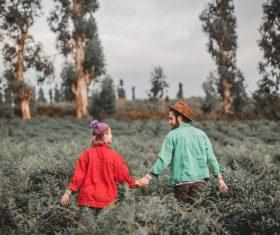 Love couple walking on farm land scene Stock Photo