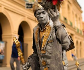 Male street artist in ancient costume Stock Photo