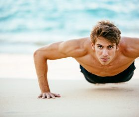 Man exercising on the beach Stock Photo 01