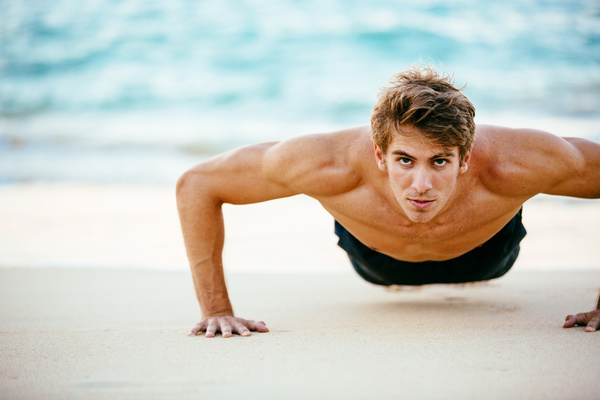 Man exercising on the beach Stock Photo 01