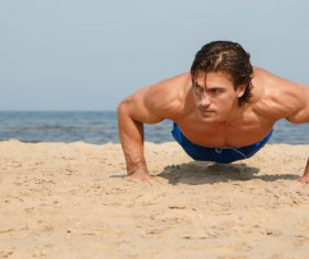 Man exercising on the beach Stock Photo 02