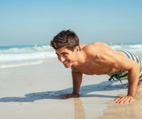 Man exercising on the beach Stock Photo 03