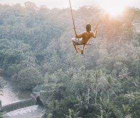 Man is swinging Stock Photo
