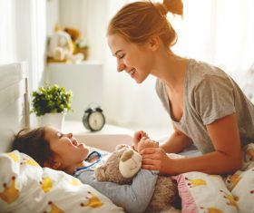 Mother calls her child to get up Stock Photo 04