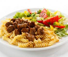 Mushroom spaghetti with salad Stock Photo