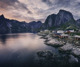 Peaceful village on calm mountain lake area Stock Photo