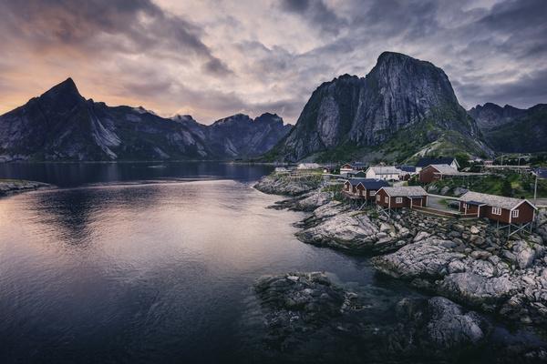 Peaceful village on calm mountain lake area Stock Photo