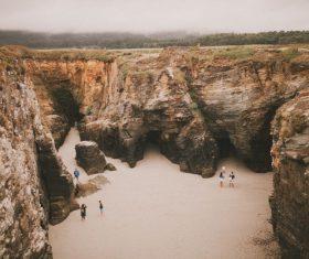 People playing on rocky seaside Stock Photo