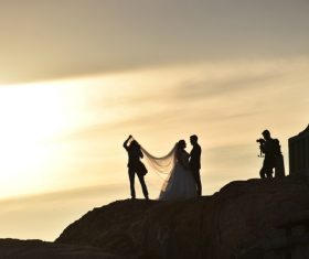 People taking wedding photo at dusk landscape Stock Photo