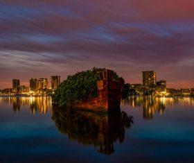 Reflection of beautiful night city on calm lake Stock Photo