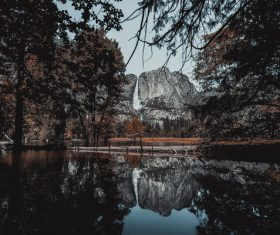 Reflection of natural park landscape on lake Stock Photo
