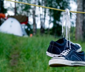 Shoes hanging on rope Stock Photo