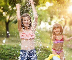 Sisters play in the water of summer Stock Photo 01