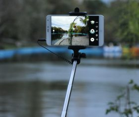 Smart phone shooting landscape Stock Photo