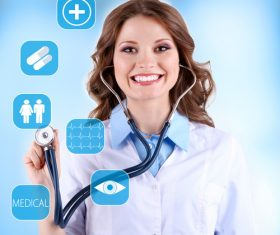 Smiling female doctor and medical service items Stock Photo