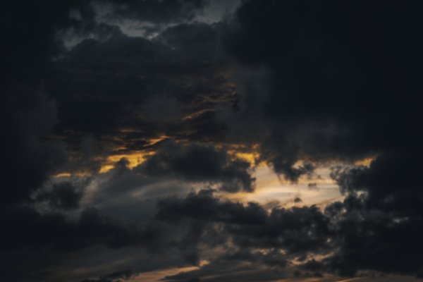 Thick black clouds on dusk sky Stock Photo
