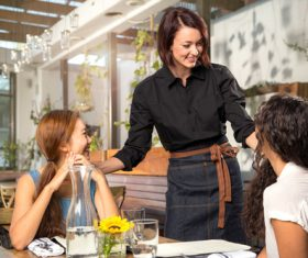 Waitress helping guests to order Stock Photo 01