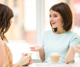 Woman chatting over coffee Stock Photo 04