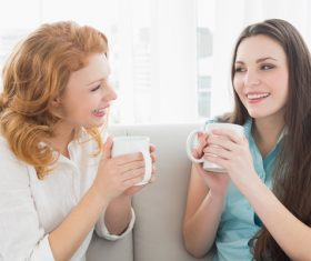 Woman drinking tea and chatting Stock Photo 02