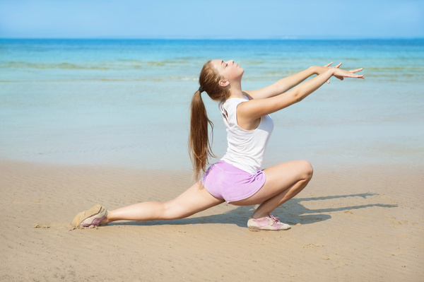 Woman exercising on the beach Stock Photo 01