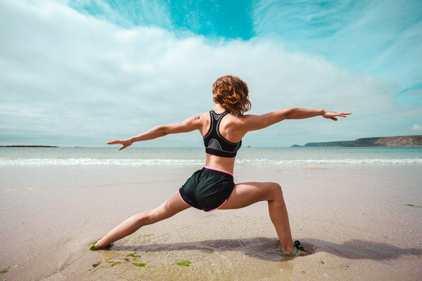 Woman exercising on the beach Stock Photo 02