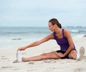Woman exercising on the beach Stock Photo 03