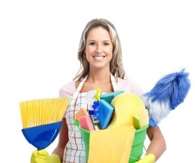 Woman holding cleaning supplies Stock Photo