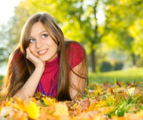 Woman lying on the ground looking into the distance Stock Photo