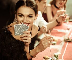 Woman playing cards in casino Stock Photo