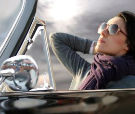 Woman sitting in convertible car Stock Photo