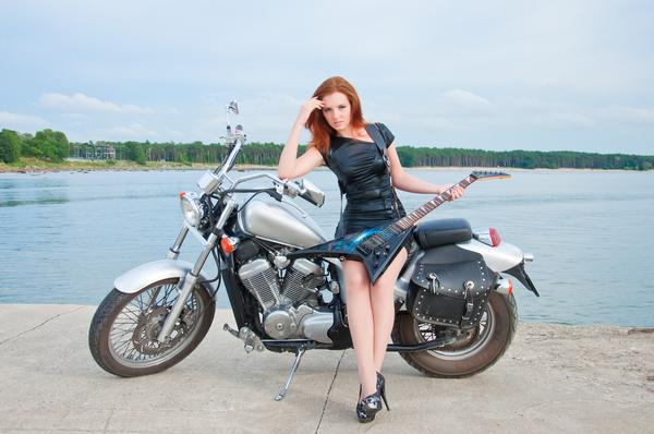 Woman sitting on motorcycle posing Stock Photo 10