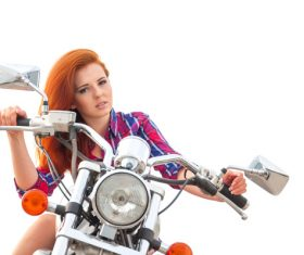 Woman sitting on motorcycle posing Stock Photo 11